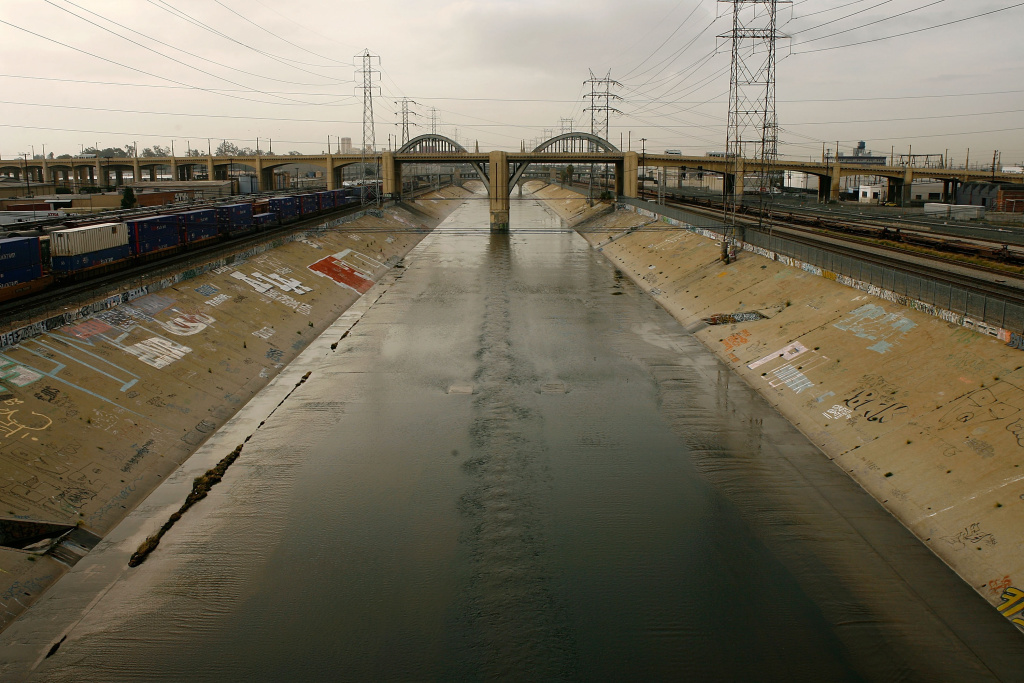 The Los Angeles River flows under the 6th Street Bridge in Los Angeles, California.