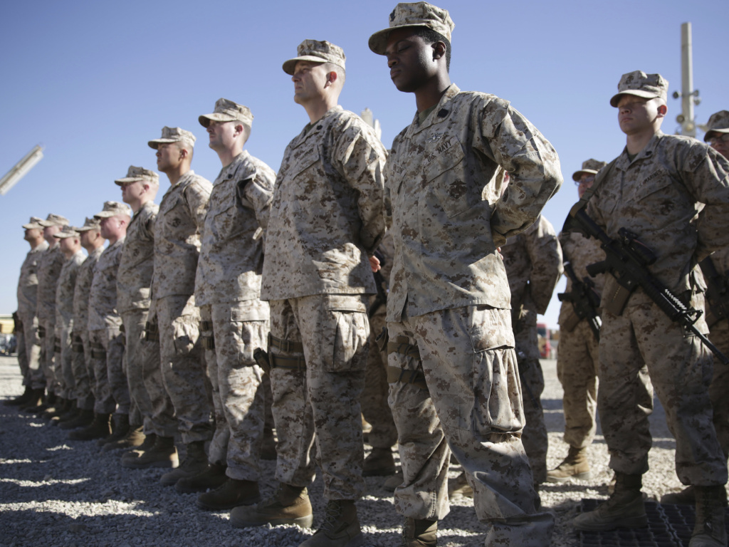 U.S. Marines stand guard during the change of command ceremony at Shorab military camp in Afghanistan's Helmand province in January 2018.