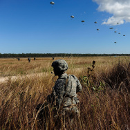 A U.S Paratrooper from 4/25th Infantry Division looks on as other members of his unit make a jump from a C-17 Globemaster as part of exercise Talisman Sabre on July 8, 2015