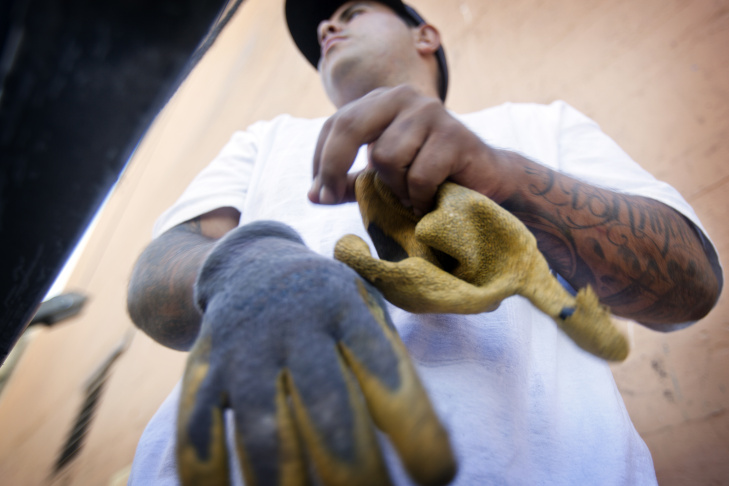 Sign painter Estevan Sanchez uses oils to hand paint an advertisement on the Figueroa Hotel in downtown Los Angeles on Sept. 27.