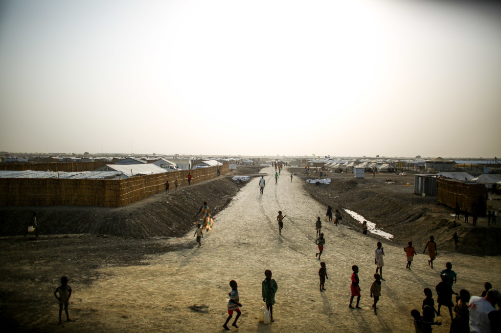 A dirt road cuts through a sprawling Doctors Without Borders camp in South Sudan. In a letter, 1,000 current and former employees are accusing the aid group of racism and white supremacy.