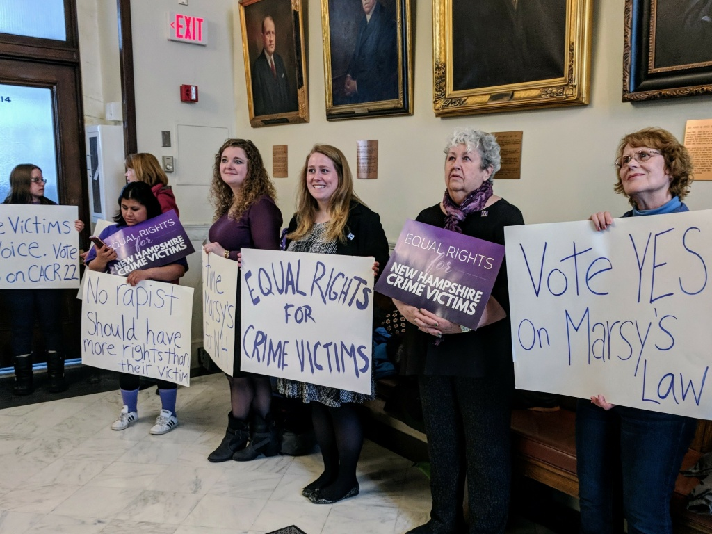 Marsy's Law supporters in a statehouse hallway in Concord. They aim to amend the New Hampshire Constitution to include more rights for crime victims.