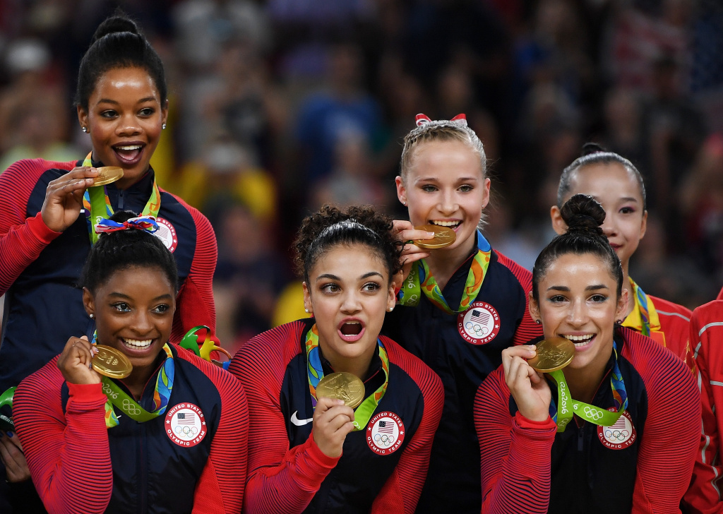 RIO DE JANEIRO, BRAZIL - AUGUST 09:  (L to R) Team USA gold medalists Gabrielle Douglas, Simone Biles, Lauren Hernandez, Madison Kocian and Alexandra Raisman