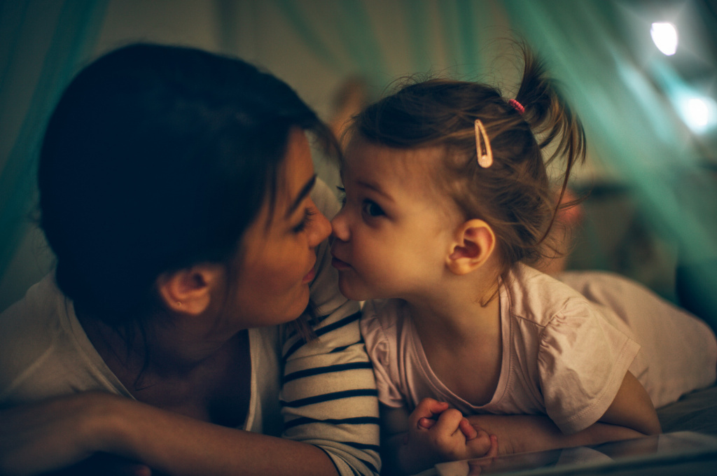 A new study suggests wrangling your kids to bed at the same time each night could help set them up for a healthier future.