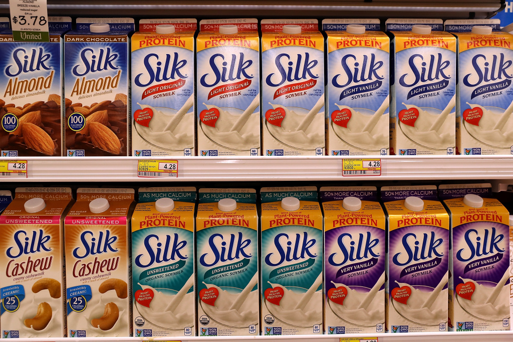 Containers of Silk soy mik are displayed on a shelf at United Market on July 7, 2016 in San Rafael, California.