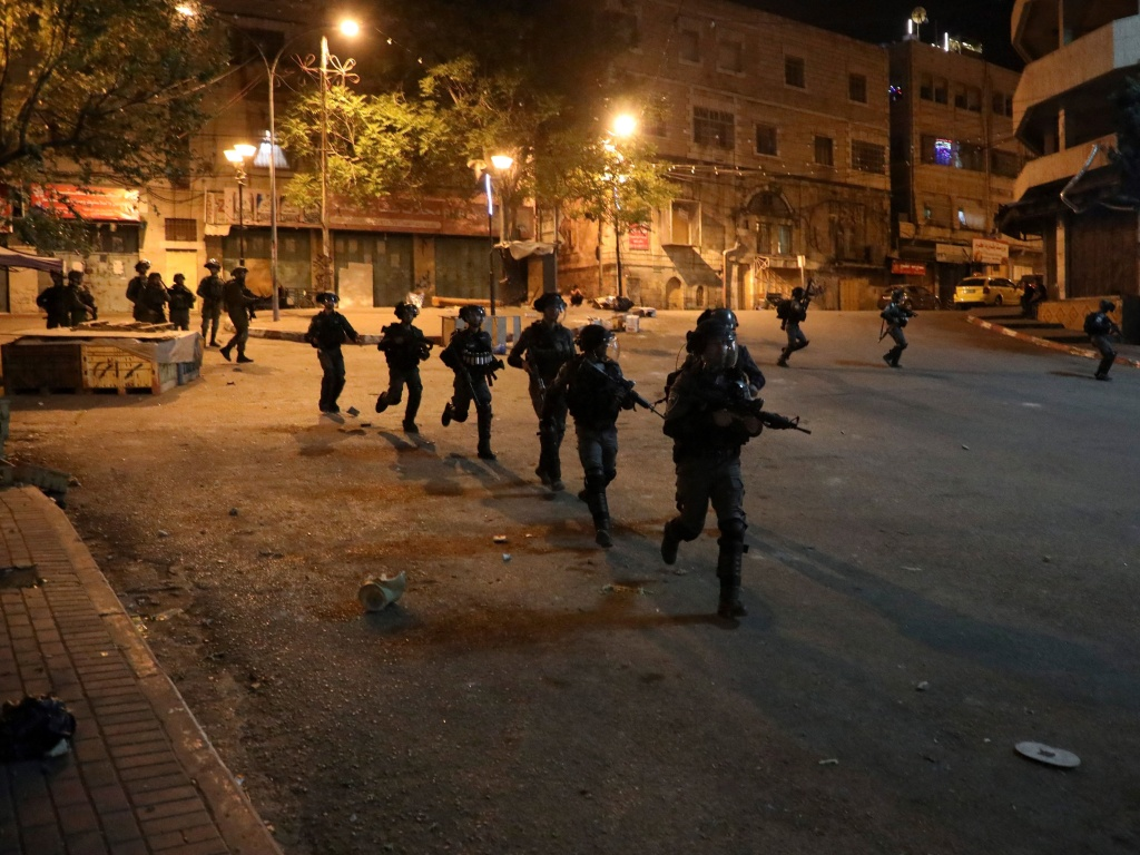 Israeli security forces on a street during clashes with Palestinian youth in Hebron on April 25.
