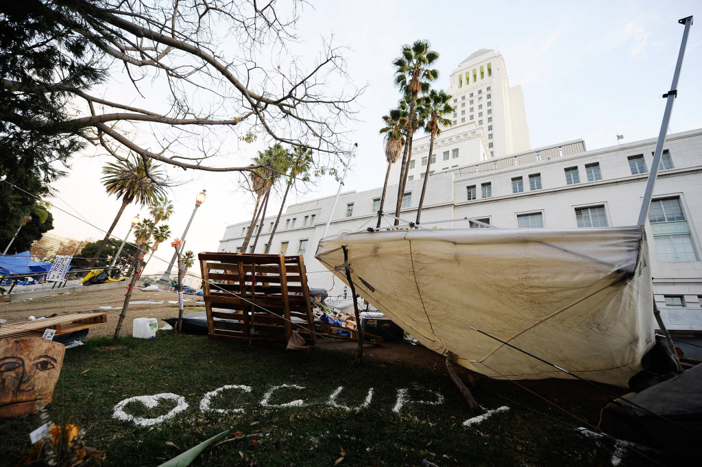 Debris and belongings of Occupy Los Angeles remain in the empty encampment at City Hall following the Los Angeles Police Department raid on November 30, 2011 in Los Angeles, California. City Attorney Carmen Trutanich is considering filing a civil lawsuit against the protesters for 2.3 million dollars in financial damages.