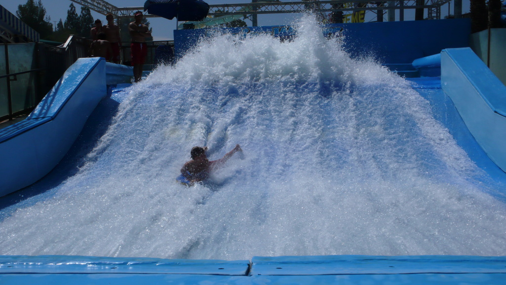 Hunter Seals, 13, of Huntington Beach tries the Flowrider at Raging Waters in San Dimas. Other kids spent the day at school.