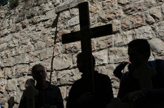 Christian pilgrims carry wooden crosses along the Via Dolorosa during the Good Friday procession in Jerusalem's old city in 2011.