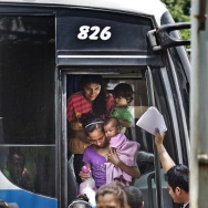 A busload of deportees arrives at El Edén center in San Pedro Sula, Honduras. The center receives Hondurans bused home after being intercepted in Mexico on their trek to the U.S. Mexico stepped up its deportation efforts after a wave of Central American migrants traveled through Mexico and reached the U.S. last year.