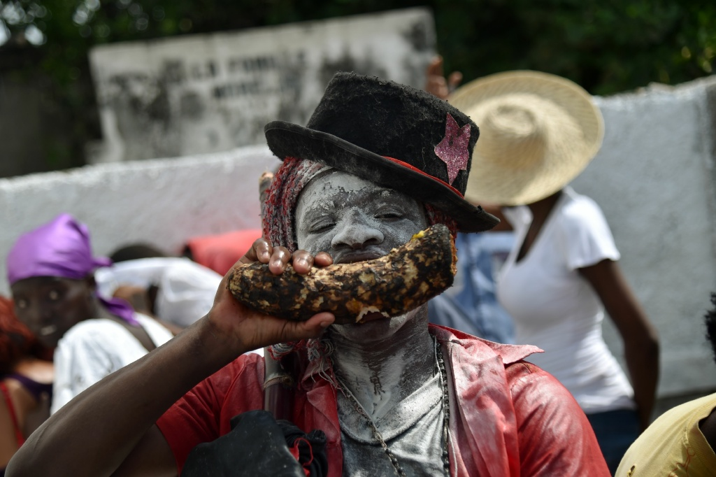 A devotee pretending to be the spirit known as a Gede looks on during a ceremony honoring the Haitian voodoo spirits of Baron Samdi and Gede on the Day of the Dead in Port-au-Prince, Haiti on November 1, 2016.