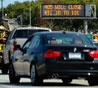 A traffic signs alerts motorists on Interstate 405 of the shutdown one day before workers start demolishing the Mulholland Bridge on Interstate 405 at the Sepulveda Pass during the 11-mile shutdown of Interstate 405 from July 16-18 for 53 hours on July 14, 2011 in Los Angeles. Los Angeles city officials are advising residents to stay home or stay away from the area over the weekend fearing massive traffic jams of what has become known as 'Carmageddon.'