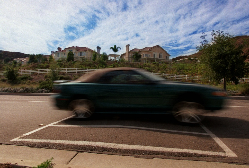 File: A car passes over a large speed bump on Coto de Caza Drive on Wednesday, Oct. 7, 1998 in Coto de Caza, Calif.