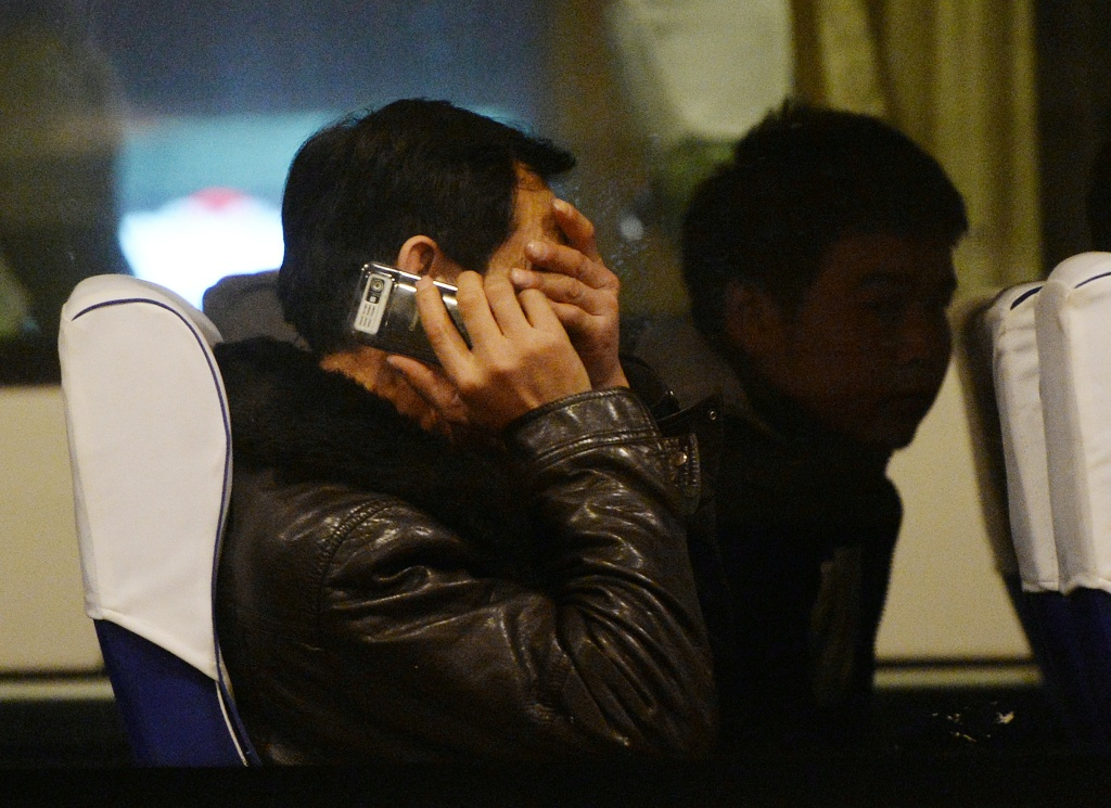 Relatives of passengers from the missing Malaysia Airlines Boeing 777-200 plane wait inside a bus at the Lido Hotel in Beijing on March 10, 2014. The desperate search for a Malaysian jet which vanished carrying 239 people was significantly expanded on Monday with frustrations mounting over the failure to find any trace of the plane. The initial zone spread over a 50 nautical miles (92 kilometres) radius around the point where flight MH370 disappeared over the South China Sea in the early hours of Saturday morning, en route from Kuala Lumpur to Beijing. Malaysian authorities announced it was doubling the size of the search area to 100 nautical miles.