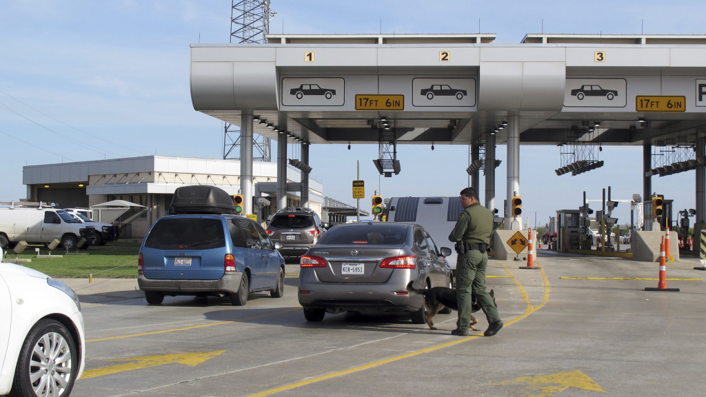 Vehicles wait for inspection at the Border Patrol's Laredo North vehicle checkpoint in Laredo, Texas. A border agent killed an immigrant woman in Rio Bravo, near Laredo on Wednesday. The shooting is being investigated by the Texas Rangers and FBI.