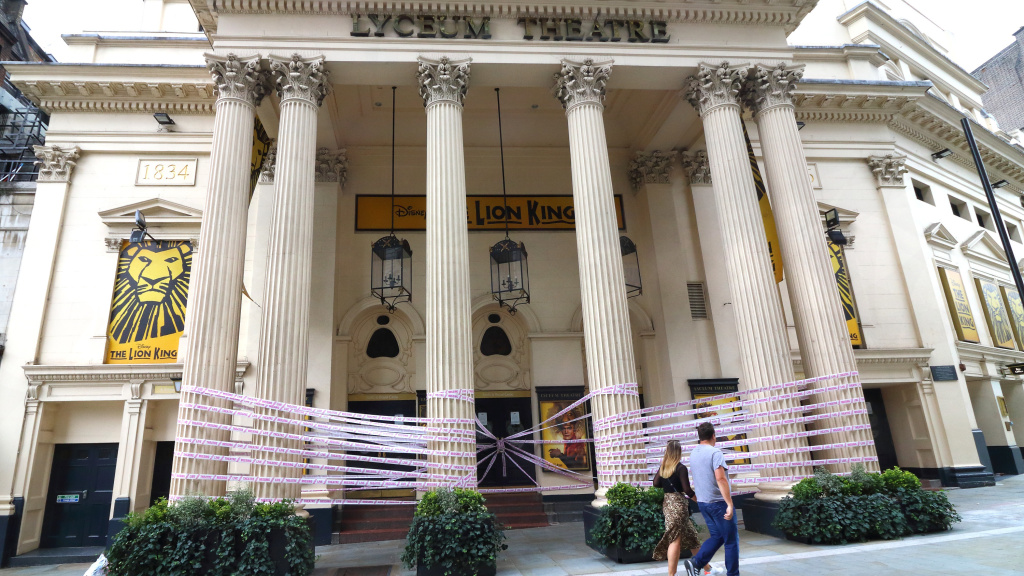 London's Lyceum Theatre is wrapped in pink tape bearing the words