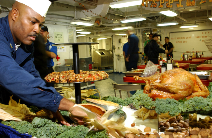 397701 06: A U.S. Navy Mess Management Specialist puts the finishing touches on a Thanksgiving Day meal November 22, 2001 for the crew of the aircraft carrier USS John C. Stennis. The USS John C. Stennis is conducting missions in support of Operation Enduring Freedom. (Photo by J. Alston Farrally II/U.S. Navy/Getty Images)