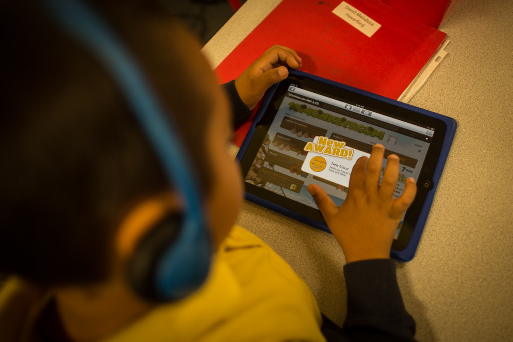 A student uses an iPad during class in Huntington Park.