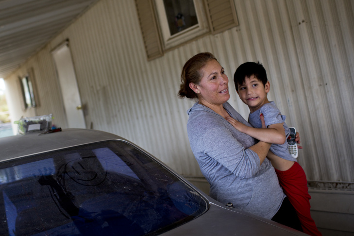 Dylan Salgado, 5. left, and Joseph Salgado, 7, play in their mobile home at Shady Lane Mobile Home Park in Thermal, Calif. on Friday, June 19, 2015.
