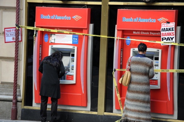 Passersby use Bank of America ATM machin