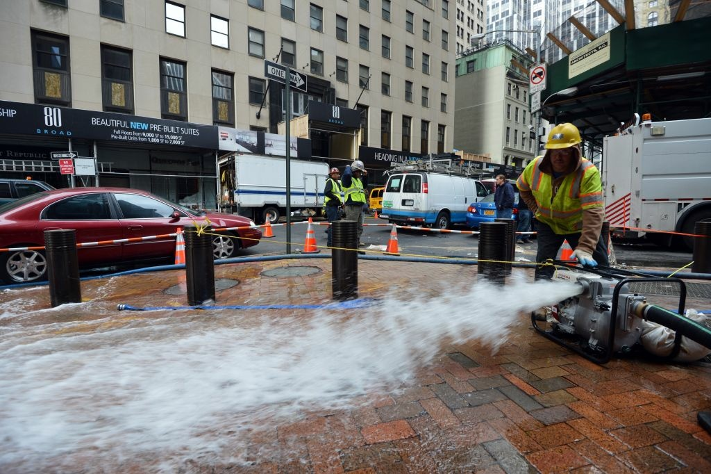 Water being pumped out of a building in Lower Manhattan October 31, 2012 in New York as the city begins to clean up after Hurricane Sandy.