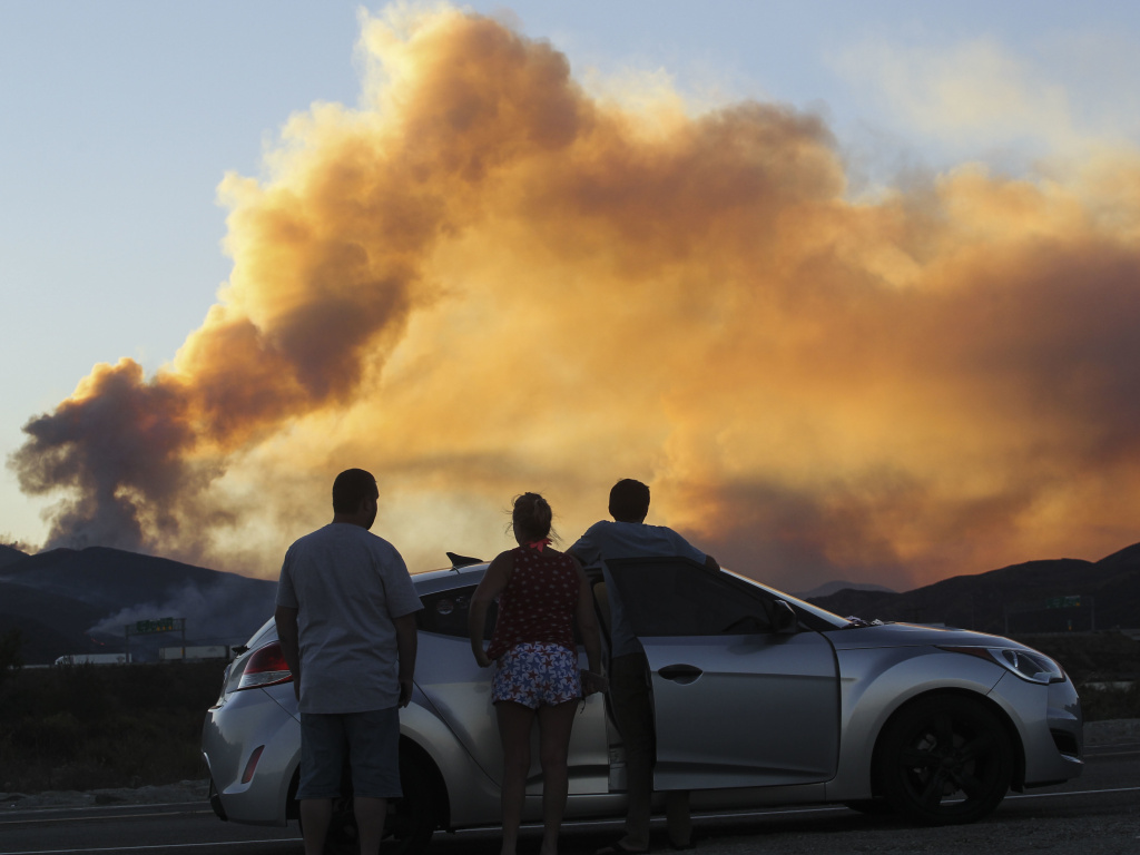 People watch the Blue Cut wildfire in Lytle Creek, Calif., in  2016.