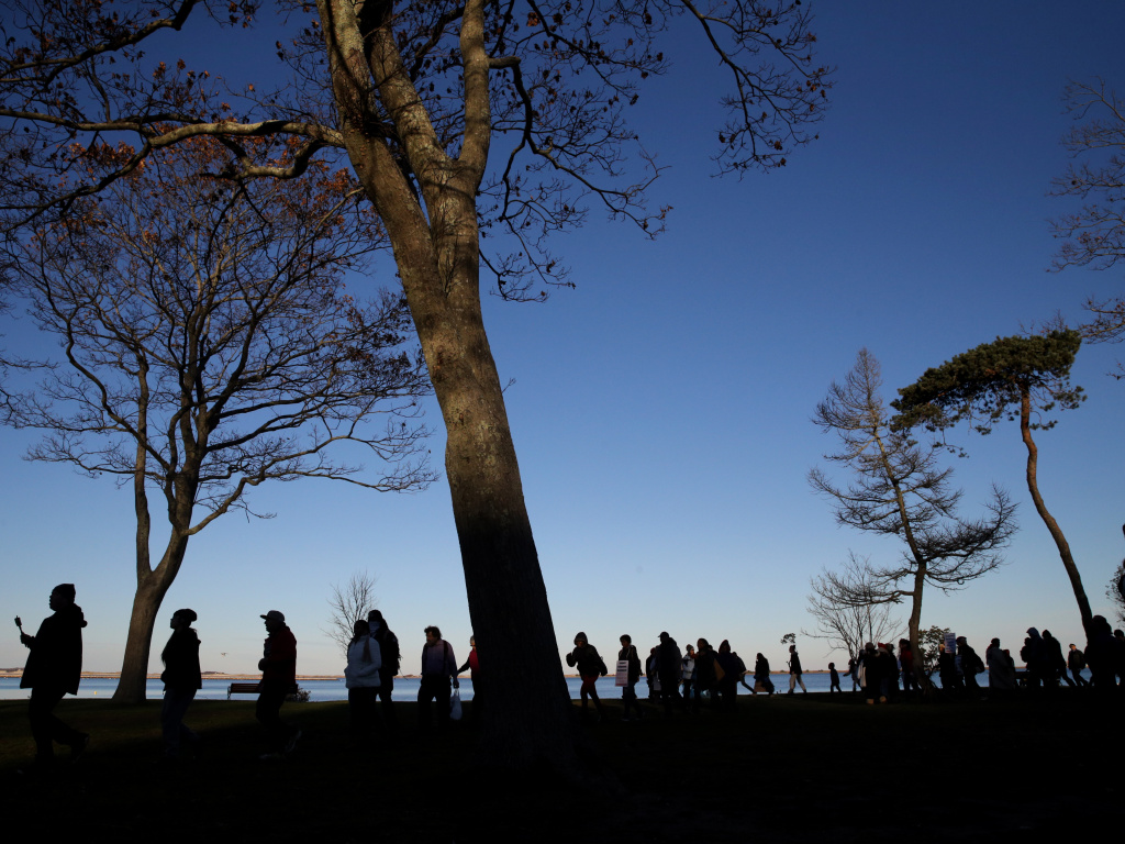 Marchers perform a Stomp Dance in Pilgrim Memorial State Park during the 48th National Day of Mourning in Plymouth, Mass., on Nov 23, 2017. Since 1970, Indigenous people have gathered at noon on Cole's Hill in Plymouth to commemorate a National Day of Mourning on Thanksgiving.