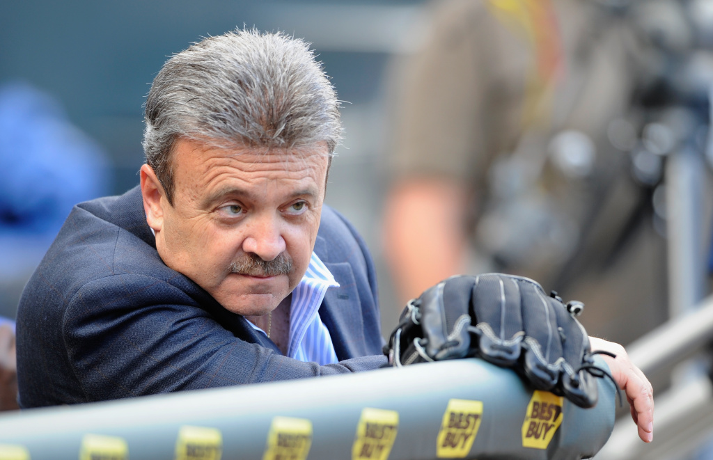 Ned Colletti, General Manager of the Los Angeles Dodgers, watches batting practice before the game against the Minnesota Twins on June 27, 2011 at Target Field in Minneapolis, Minnesota.