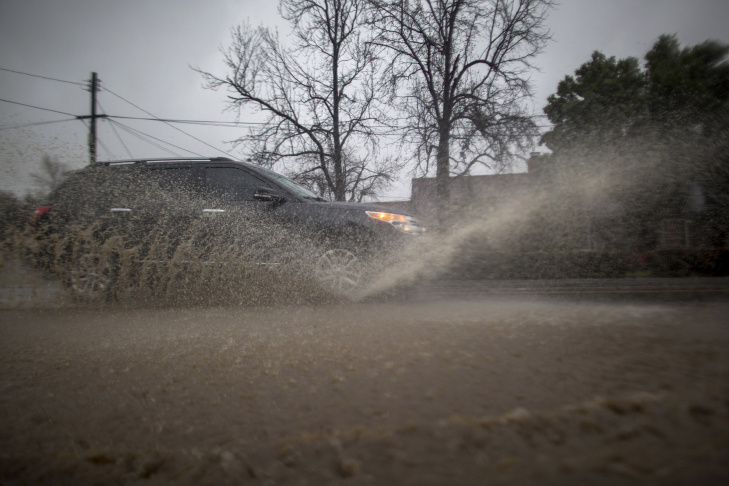 A man boards a bus on a flooded street as a powerful storm moves across Southern California on Feb. 17, 2017 near Sun Valley, California. After years of severe drought, heavy winter rains have come to the state, and with them, the issuance of flash flood watches in Santa Barbara, Ventura and Los Angeles counties, and the evacuation of hundreds of residents from Duarte, California for fear of flash flooding from areas denuded by a wildfire last year.