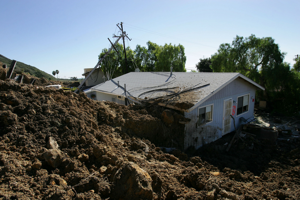 A home damaged in the deadly mudslide that killed at least 10 people is one of those that residents will not be allowed to enter on the first day that evacuated residents are allowed to return to their devastated community January 14, 2005 in La Conchita, Calif. With at least three people still missing, rescuers suspended search efforts after the hillside above shifted, raising concern that another mudslide could occur. 15 homes were destroyed and 16 damaged when the mudslide poured over part of the small seaside town of 260 people at the end of the area's heaviest rainfall in a 15-day period since records began in 1921.