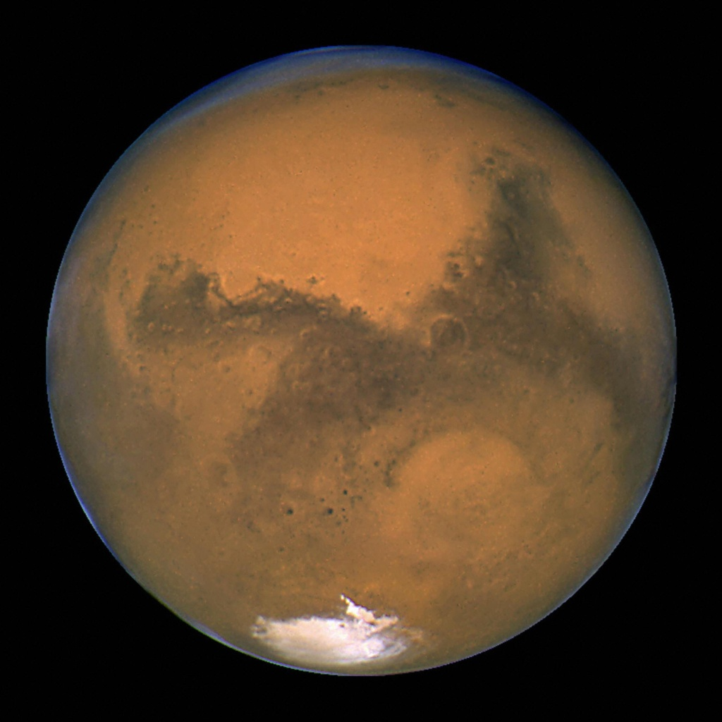 IN SPACE - AUGUST 26: This image released August 27, 2003 captured by NASA's Hubble Space Telescope shows a close-up of the red planet Mars when it was just 34,648,840 miles (55,760,220 km) away. This color image was assembled from a series of exposures taken between 6:20 p.m. and 7:12 p.m. EDT August 26, 2003 with Hubble's Wide Field and Planetary Camera 2. The picture was taken just 11 hours before the planet made its closest approach to Earth in 60,000 years. Many small, dark, circular impact craters can be seen, attesting to the Hubble telescope's ability to reveal fine detail on the planet's surface.