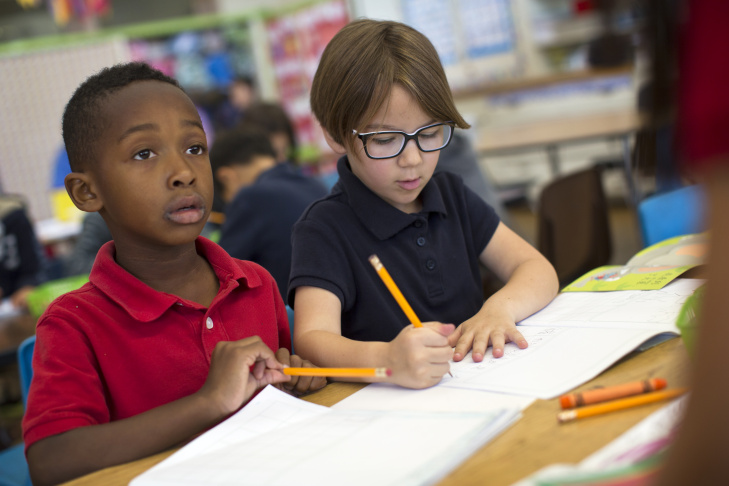 Kindergartener Gemma Gomez hands in classwork to teacher Tingting Mei at Eugene Field Elementary on Thursday morning, May 28, 2015. Instead of choosing the elementary school blocks from their home, Duarte mom Brooke Gomez decided to send her daughter to the Mandarin immersion school in Pasadena.