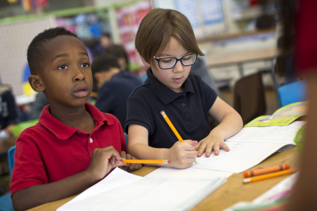 Kindergarteners Bryden Musgrove, left, and Gemma Gomez take part in a writing exercise in Mandarin at Eugene Field Elementary, a dual immersion school in Pasadena, on Thursday morning, May 28, 2015. Kindergarten students at the school spend 90 percent of their day learning subject areas in the Mandarin language.