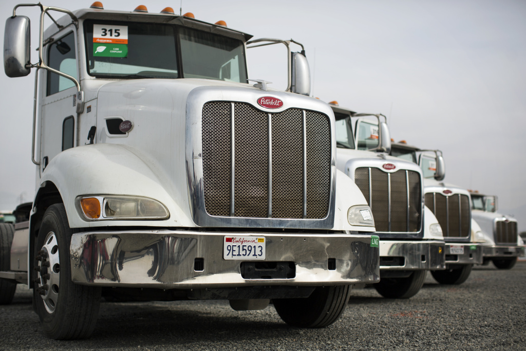 File: Peterbilt 384 liquefied natural gas trucks are in line to be auctioned off at Ritchie Bros. Auctioneers in Perris, Calif. on Friday, Dec. 9, 2016.