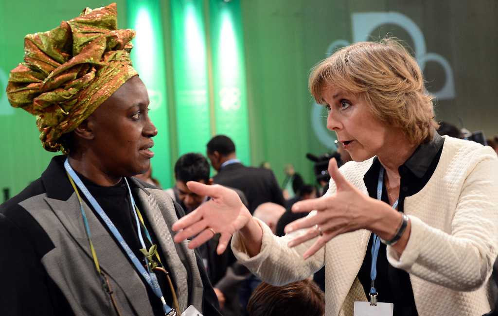 EU Commisioner for Climate Action Connie Hedegaard (R) talks with Alice Akinyi Kaudia from Kenya prior to the opening of the High-level Segment of th UN Climate Change Conference in Warsaw on November 19, 2013.