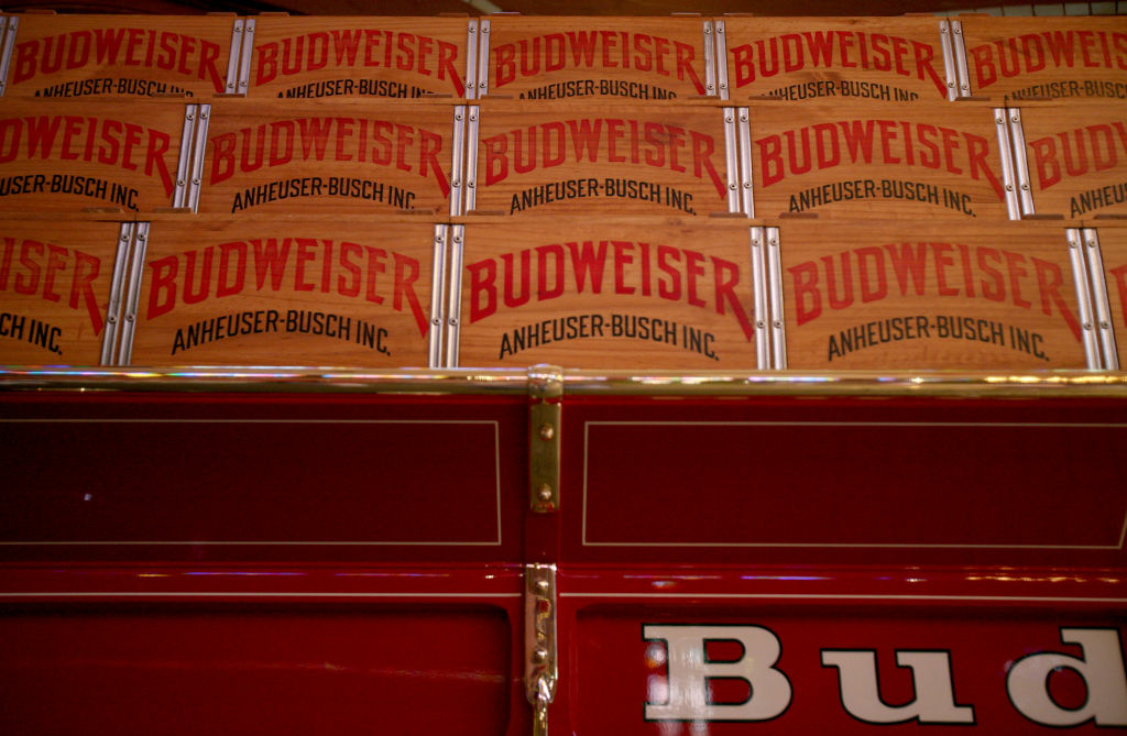 Wooden beer cases are seen on display inside a stable for the Budweiser Clydesdales during an Anheuser-Busch Cos. brewery tour.