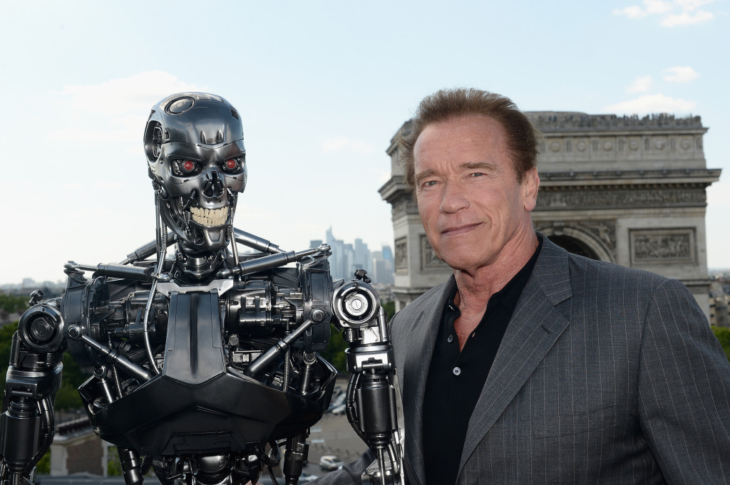 Actor Arnold Schwarzenegger poses with Endoskeleton during the France Photocall of 'Terminator Genisys' at the Publicis Champs Elysees on June 19, 2015 in Paris, France.