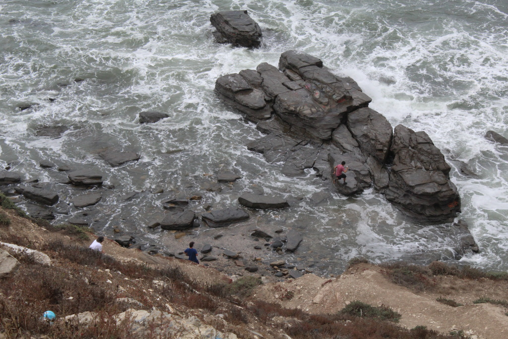 Visitors explore the rocky shore of the Sunken City in this file photo. Rescuers responded to a call of a person possibly drowning in the surf in the area shortly before 4 p.m. Monday.