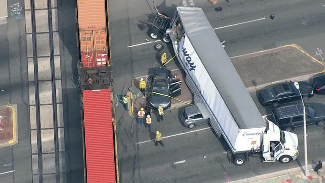 An 18-wheeler crashed with at least two other cars in the city of Industry on Tuesday.