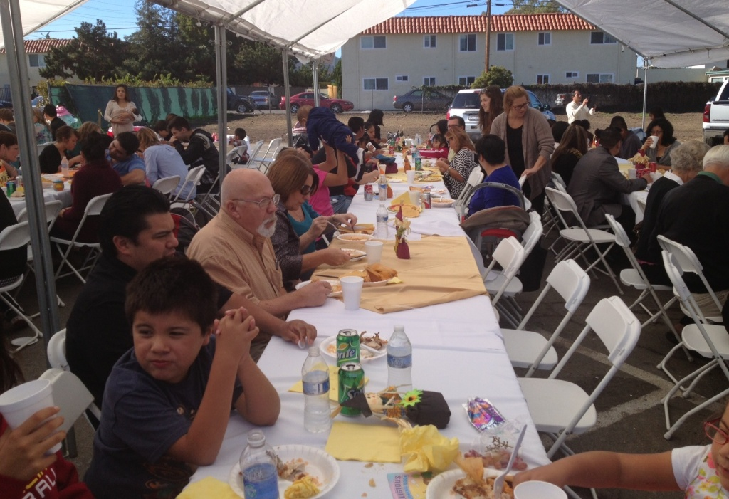 Congregants from the diverse evangelical churches that worship in the Harbor Christian Fellowship building in Costa Mesa, Calif. enjoy an after-church Thanksgiving potluck, Nov. 24, 2013.
