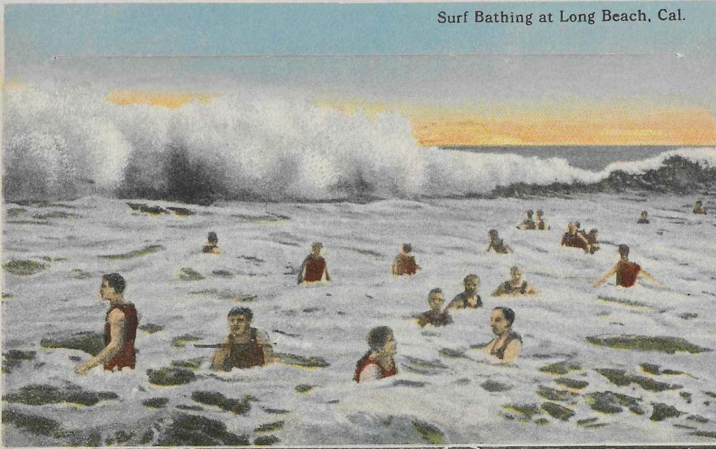 Early 20th century post card shows large waves and active beach culture in Long Beach.