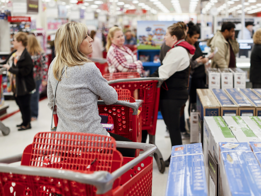 Shoppers wait in line at a Target store in Newport, Ky., on Nov. 29, 2018. Strong consumer spending boosted analysts' economic growth forecasts for the first quarter of 2019.