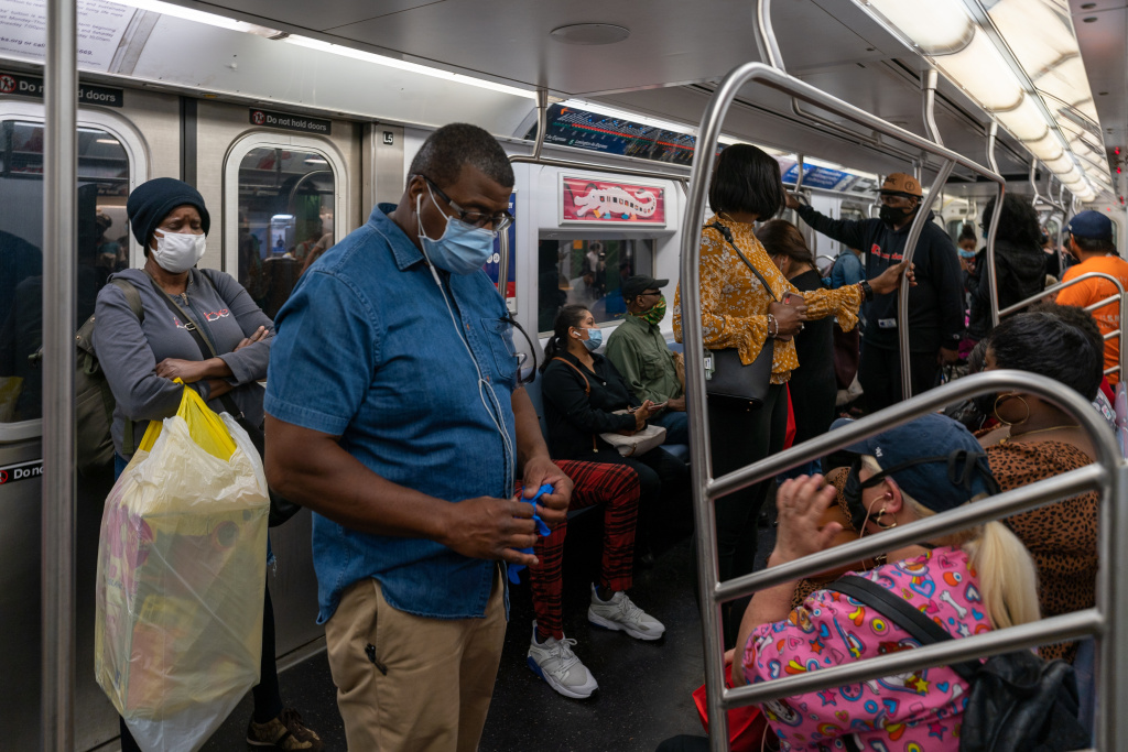 People ride the subway on the first day of phase one of the reopening after the coronavirus lockdown on June 8, 2020 in New York City.