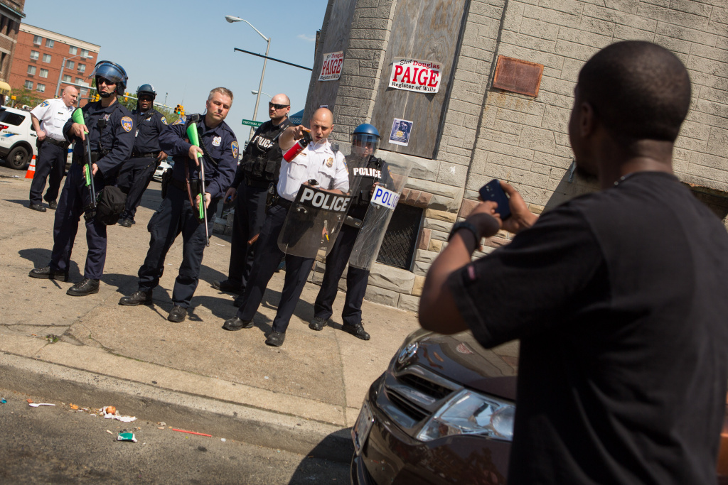 A man faces off with police on North Ave., near the site of recent riots and several blocks away from where Freddie Gray was arrested May 4, 2015 in Baltimore, Maryland.