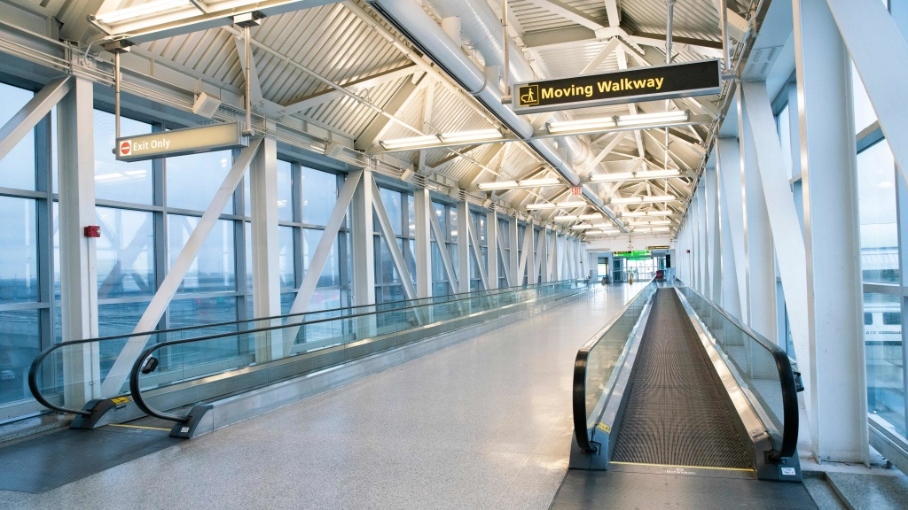 An empty corridor at John F. Kennedy International Airport in New York last month. Social distancing to slow the spread of the coronavirus leaves little demand for flights.