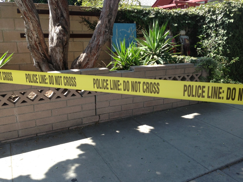 Police tape blocking the Culver City Police Department's parking lot following an officer-involved shooting Saturday morning, Sept. 21, 2013.