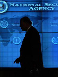 Former Director of National Intelligence John Negroponte walks the hallways of the Threat Operations Center inside the National Security Agency in Fort Mead, Maryland in this January 25, 2006 file photo