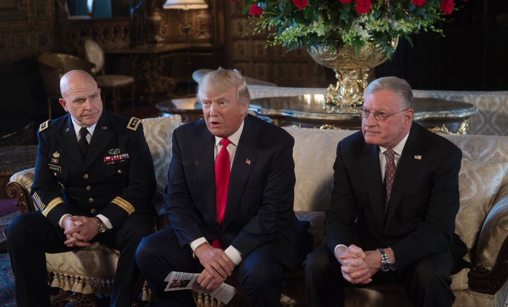 US President Donald Trump (C) announces US Army Lieutenant General H.R. McMaster (L) as his national security adviser and Keith Kellogg (R) as McMaster's chief of staff at his Mar-a-Lago resort in Palm Beach, Florida, on February 20, 2017.