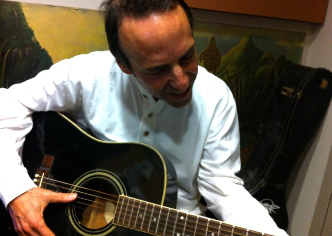 Musicologist and Huffington Post blogger Michael Sigman plays the Off-Ramp office guitar.