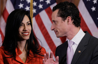 FILE - In this Jan. 5, 2011, file photo, Rep. Anthony Weiner, D-N.Y., and his wife, Huma Abedin, aide to Secretary of State Hillary Rodham Clinton, are pictured after a ceremonial swearing in of the 112th Congress on Capitol Hill in Washington.